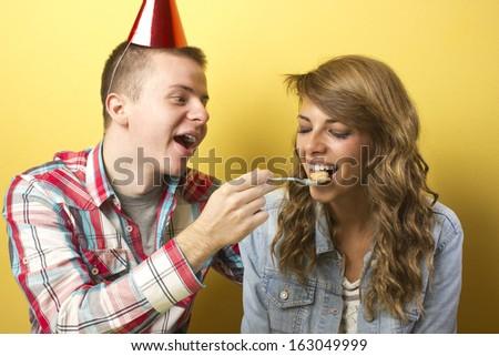 Man feeding his girlfriend - stock photo