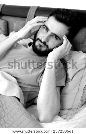 Man feeling sick with strong migraine - stock photo