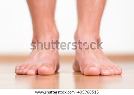 Man feet close-up - stock photo