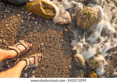 man feet on beach sand - stock photo