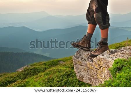 man feet on the rock - stock photo