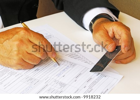 Man filling credit card data - stock photo