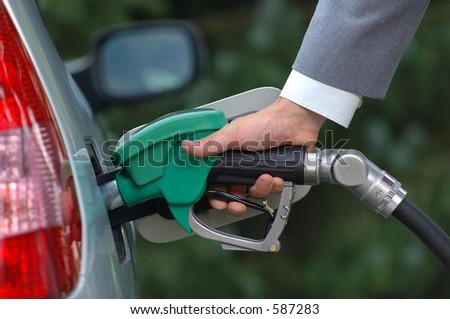Man filling fuel tank