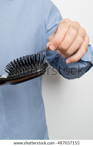 man finds his hair in the hairbrush