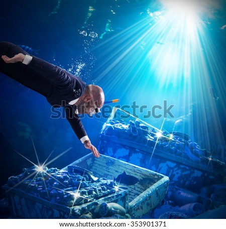 Man finds trunks with treasures under water - stock photo