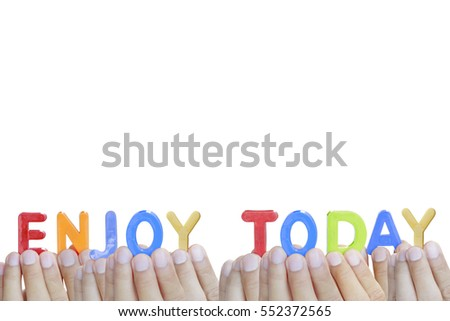 "Man fingers showing ""ENJOY TODAY"" text on white background"