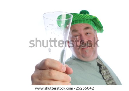 man finishes his beer on st patties day - stock photo