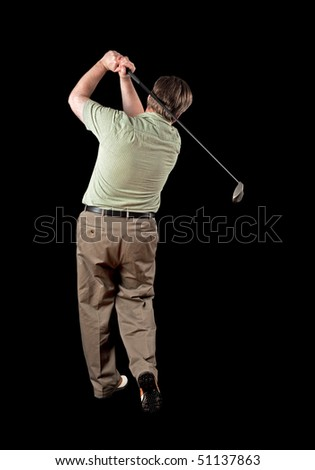Man finishing his golf swing on a black background. - stock photo