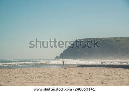 Man fishing at the beach of Morgans Bay. Eastern Cape. South Africa. - stock photo