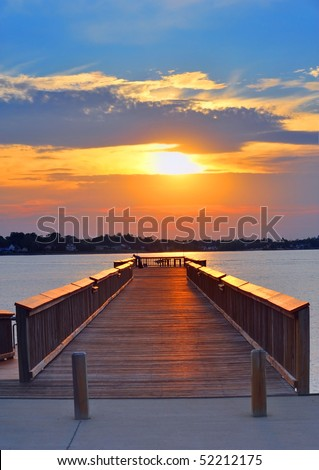 Man fishing from a pier on the Chesapeake Bay Maryland at sunset - stock photo