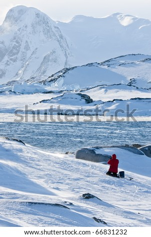 Man fishing in a snowstorm. Antarctica - stock photo