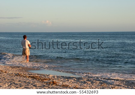 Man Fishing Ocean Sunset Sanibel Island Florida - stock photo