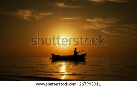 Man fishing on Beautiful sunset - stock photo