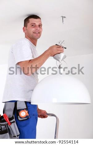 Man fitting light - stock photo