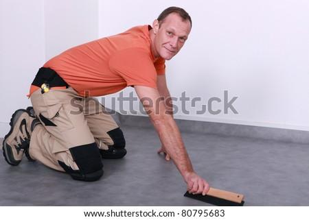 Man fitting new flooring - stock photo
