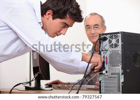 Man fixing a computer - stock photo