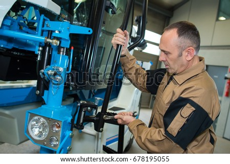 man fixing a machine
