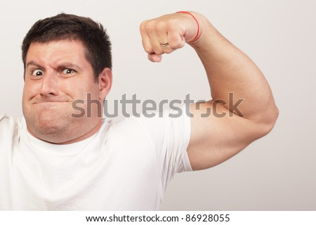 Man flexing his arm - stock photo