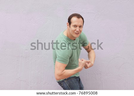 Man flexing his arms - stock photo