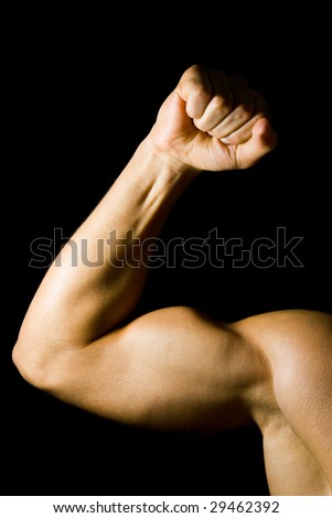Man flexing his bicep muscle - stock photo