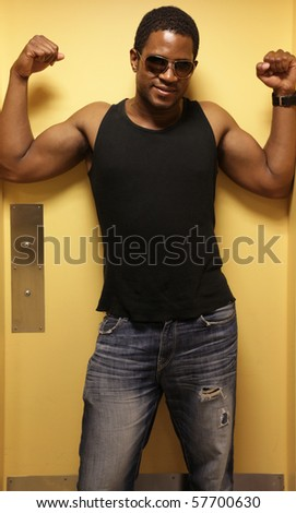 Man flexing in doorway - stock photo