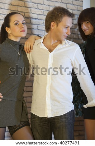 man flirting with another woman in a disco - stock photo