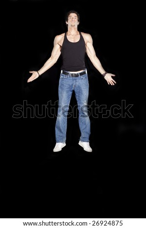 Man floating in angelic pose - stock photo