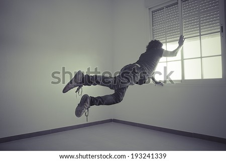 man flying into a window, concept of freedom and imagination - stock photo