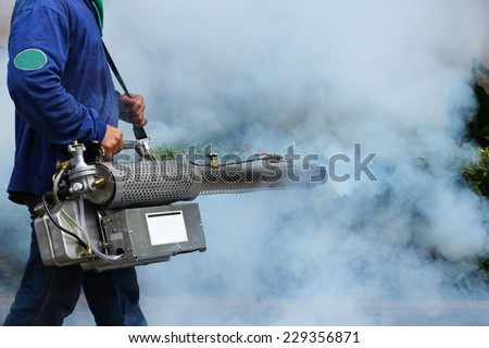 Man Fogging to prevent spread of dengue fever in thailand - stock photo