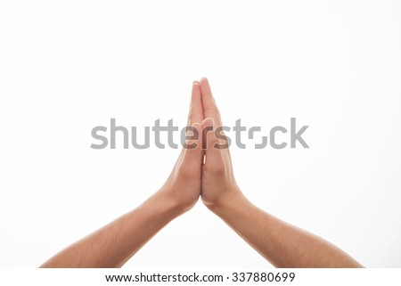 Man folds hands for plea, white background - stock photo