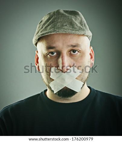 Man forbidden speaking concept - stock photo
