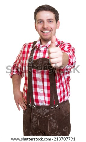 Man from Bavaria in leather pants showing thumb up - stock photo