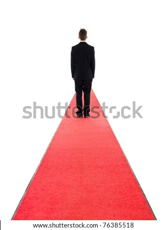 Man from behind on a red carpet isolated on white background