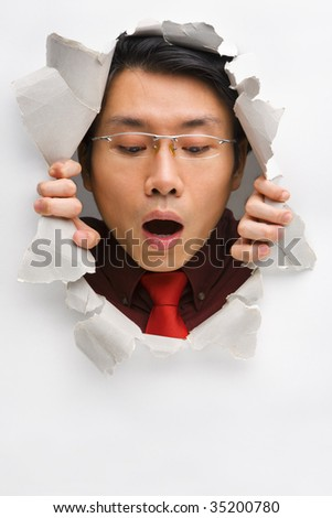 Man from hole looking down to empty space below with surprised expression - stock photo