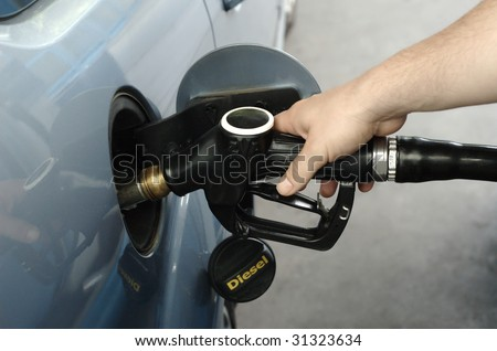 Man fueling car with diesel - stock photo