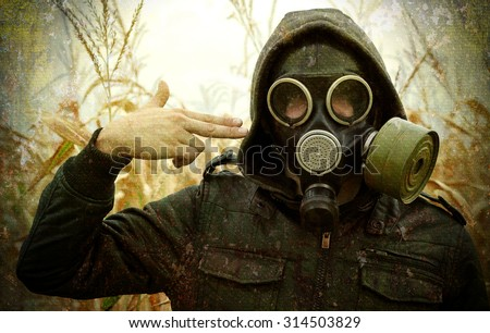 man gas mask gun concept the danger of war rusty grunge background