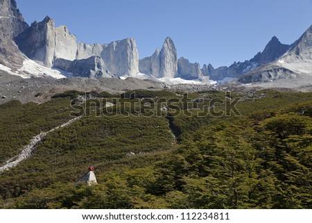 Man gazing at the amazing valle frances in torres del paine, Chile - stock photo