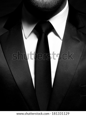 Man gentleman in black suit and tie - stock photo