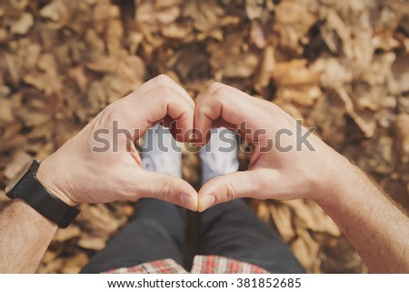 Man gesturing heart shaped hands.  - stock photo