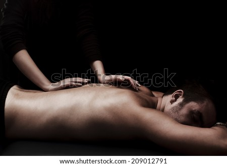 Man getting a back massage at spa - stock photo