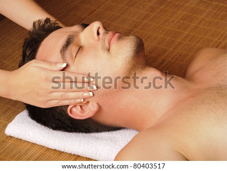 Man getting a face massage - stock photo