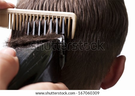 Man getting a haircut by a hairdresser.  - stock photo