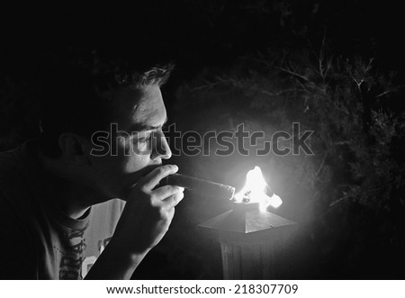 Man getting a light from cigar - stock photo