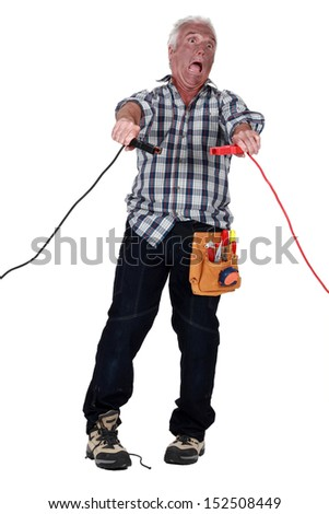 Man getting an electric shock - stock photo