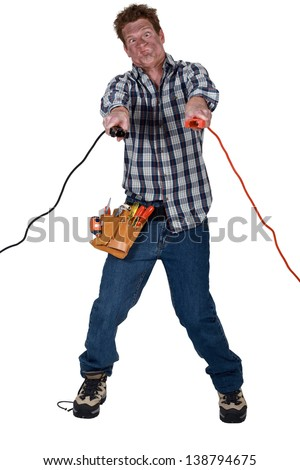 Man getting an electric shock from jump leads - stock photo