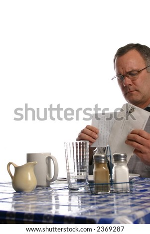 man getting bad news in the mail at cafe - stock photo