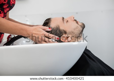 Man Getting Hair Washed In Parlor