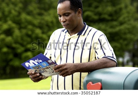 Man getting mail - stock photo