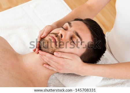 Man getting massage in the spa centre - stock photo