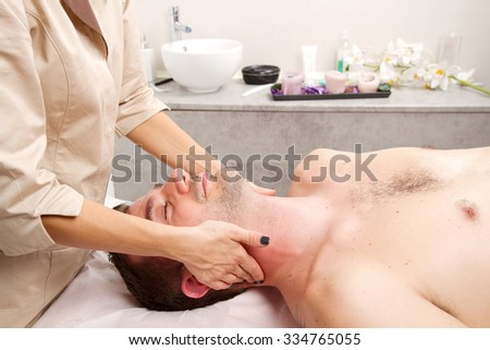 Man getting massage in thebeauty center - stock photo